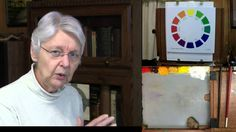 Art teacher Dianne Mize demonstrates the science behind mixing neutral colors.