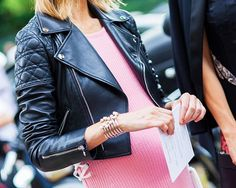 A pink sweater dress is worn with black leather.