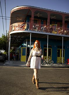A pedestrian adds to the color along Frenchman Street. (Photograph by Kris Davidson)