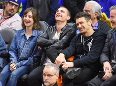 Alison Brie, Dave Franco & James Franco from The Big Picture: Today's Hot Photos  Three's company! The group has some fun at the Warriors vs. Clippers game in L.A.