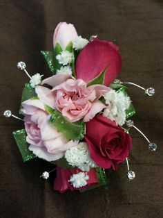 Prom Corsages Go for the BLING baby. Designer Denna Gundrum Penny's Florist Shop Greenfield, IN