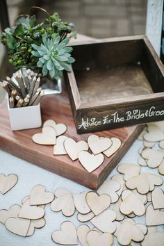 Wood cutouts for guests to write advice for the bride groom {Photo by Troy Grover Photographers via Project Wedding}