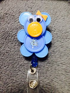 retractable+id+badge+holder,+made+with+recycled+medicine+vial+caps.+colors+upon+request,+can+be+customized+to+be+male+or+female+upon+request. Nurse Art, Nurse Badge, Bottle Top Art, Nurse Crafts, Badge Buddy, Work Badge, Id Badge Holders, Badge Reel, Diy Buttons