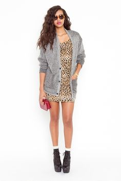 I love that grey sweater, i like the dress too, but its waaaay too short for me