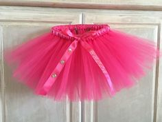 A personal favorite from my Etsy shop https://www.etsy.com/listing/526678274/pink-tutu-pink-satin-ribbon-wrapped