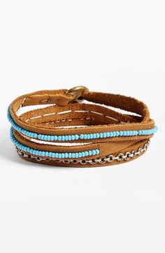 "Free shipping and returns on Me to We Artisans Tatu Three-Wrap Bracelet (Juniors) at Nordstrom.com. ""Tatu"" is the Swahili word for ""three,"" the number of times this exquisite leather bracelet sewn with shimmering glass beads and brass rings will elegantly encircle your wrist."