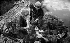 """ VIETNAM INC. by Philip Jones Griffinths GI's often show a compassion for the enemy that springs from admiration of their dedication and bravery. This VC had a three-day-old stomach wound. He'd picked up his intestines and put them in an enamel. Vietnam History, Vietnam War Photos, American War, American Soldiers, American History, North Vietnam, War Photography, Photographer Portfolio, Magnum Photos"