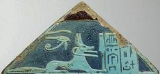 """the God Anubis in His form of sacred jackal with the 'sekhem'-scepter; behind Him, the 'Udjat'-Eye. Detail from the triangular stele (faience) of Amenemheb, """"Overseer of the artisans of Ptah""""; from Saqqara, ca. 1550-1070 BCE. Now in the Rijksmuseum..."""