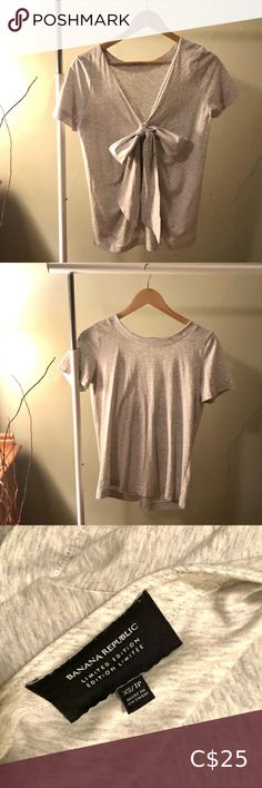 Banana Republic Bow Back Tee Limited Edition Top First pic is the back of the top showing a deep V and now. 100% cotton supima. Great condition, worn only a couple times. Feel free to message me if you have any questions. Banana Republic Tops Tees - Short Sleeve Black Short Sleeve Tops, Black Lace Tops, Long Sleeve Tops, Banana Republic Shorts, Banana Republic Tops, Bow Back, Striped Crop Top, Deep, Couple