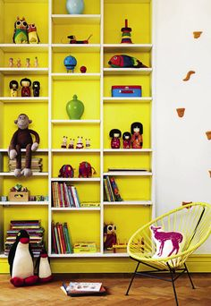 Kid's Room Ideas: wall & baseboard behind bookcase painted yellow and the rest kept white for a pop of color