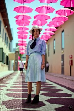 I took this street style photo of Wara who works as store manager at Pitti Umom in Florence 2013. She is wearing shoes - Topshop, skirt - COS, shirt - united arrows, hat - Super Duper Hats.