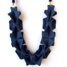 Another origami-themed trend is metal earrings and necklaces made to look as though they were folded into shape. Description from wellroundedfashion.com. I searched for this on bing.com/images