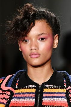 Draping — or blushing from the temples to the apples — was happening in full force at Adam Selman, where makeup artists swept the same shade of punchy-pink on cheeks, eyes, and lips. #refinery29 http://www.refinery29.com/2016/09/123393/best-hair-makeup-trends-nyfw-pat-mcgrath-ss17#slide-4