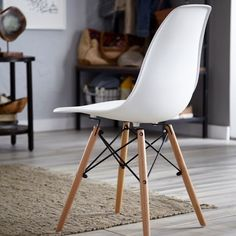 This sleek and stylish CANVAS Henrik Chair is a combination of contemporary design and comfort, it features a white plastic seat with solid wooden legs