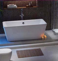 Inspiration from Bathrooms.com: Low lighting, especially candlelight, is best for a relaxing atmosphere. Choose candles with your favourite scent for best effect. Newbury bath, from Bathrooms.com. #bath #bathroom #spa #wetroom