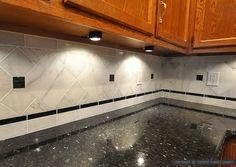 black granite and dark cabinets lighten up kitchen with