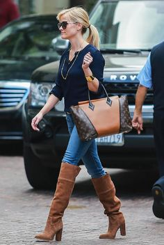Reese Witherspoon pairs her jeans with over-the-knee suede boots