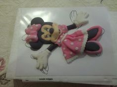 Had to share this technique. My mother in law did this.  I have never seen this made from fondant bidimensional all fondant minnie mouse.  Looking forward to her visit so she can teach me. Wanted to share in case anyone else out there never saw this before.