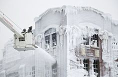 Chicago fire department turns a building on fire into an icesculpture because of the cold.