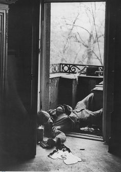Machine gunner Raymond J. Bowman of Rochester, NY, lies dead on the balcony of a German house after being targeted by an enemy sniper. Bowman was killed on April 18, 1945. On April 2, he had celebrated his 21st birthday. The photographer was the famous war photographer Robert Capa -- who himself was KIA in SE Asia a few years later. Bowman belonged to 23rd Infantry Regiment, 2nd Infantry Division.