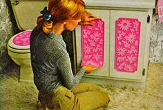 70s shag carpeting in the bathroom Ewwwww! ... though I gotta say I'm attracted to the pink vinyl appliques.