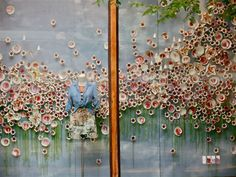 Anthropologie window display... maybe something to think of with small flowers for a backdrop! :)