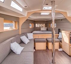 Beneteau Oceanis 38: The salon table comes out in minutes, as do the two square benches that fasten to the cabin sole to form the U-shaped dinette.