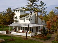 Coastal Farmhouse: This home's exterior was inspired by the design of shingle-style cottages that dot the coastline of Cape Cod, Martha�s Vineyard and Nantucket. Long-lasting metal roofing is an eco-friendly choice. From HGTVRemodels.com