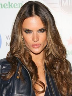 A long, layered cut looks gorgeous on everyone, but especially those with a square-shaped face. The chin-length layer helps offset the angular lines of the jaw, framing the face perfectly. LONG AND LAYERED We love how Alessandra Ambrosio usually wears her Rapunzel-like layered 'do—complete with tousled curls that are super sexy.