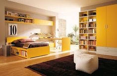 Yellow-color-teen-bedroom-with-combination-bookshelves-and-wardrobes