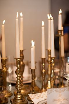 Brass candle sticks with blush candles for the table centres