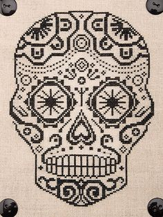 Cross stitch this skull pattern for Halloween