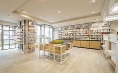 The open layout of this store is commercial. It is accessible to everyone, even with disabilities. It is made of durable materials. Retail Store Design, Retail Shop, Pharmacy Store, Drug Store, Pharmacy Humor, Fashion Retail Interior, Industrial Office Design, Shelving Design, Wood Interior Design