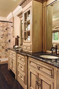 Bathroom Vanity...change the color and door design but like the style with the tower and bump out in the middle