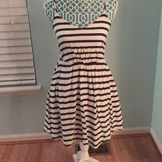 Lauren Conrad dress This is a Lauren Conrad dress. It is a size 6 and made of rayon and has a polyester lining. This dress was worn once. It is navy and white strips and has adjustable straps. It hits mid thigh and will fit a small/medium. Lauren Conrad  Dresses Midi