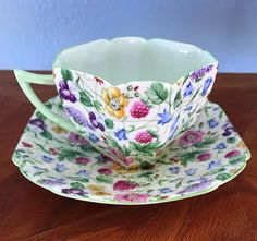 """Beautiful and popular Queen Anne Countryside Tea Cup and Saucer. No chips, cracks, hairlines or repairs. #13690 Full size measuring: - APPROXIMATE DIMENSIONS- CUP IS 4-1/4"""" width including handle x 2-5/8 height SAUCER: 5-1/2 square x 5/8 height"""