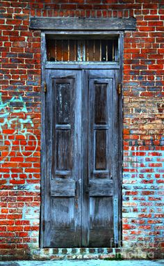 Old Door With Bricks. By Perry Webster