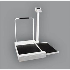 "Detecto Digital Wheelchair Scale -   DIGITAL. Pounds & Kilograms. 30"" x 26"" platform with non-skid mat. Designed to accomodate all sizes of wheelchairs. Padded handrail for ambulatory patients. Ramp is designed for a smooth approach and exit. White with black mat and hand grips. Weight capacity: 400 Lbs x 0.2. Lbs. Height: 36"". 1 Year Warranty."