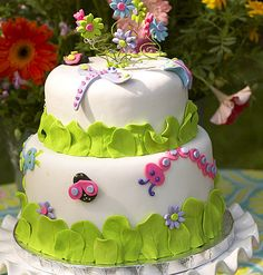 Cake with bugs and butterflies.