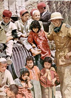 Afrikakorps soldier and Arab children