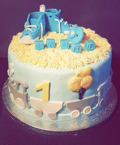 Babyboy 1st birthday cake. Fondant shoes.