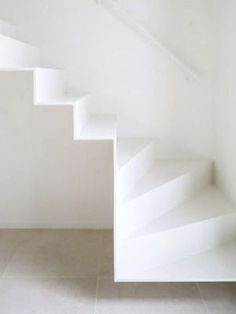 smooth white floating stairs.