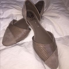 NWOT!! Vince Camuto flats! Never been worn! I got them as a present to myself, decided to splurge, but they are just too small for me! My loss is your gain! They are a soft material and a faux snake skin pattern. Thanks for looking! Vince Camuto Shoes Flats & Loafers