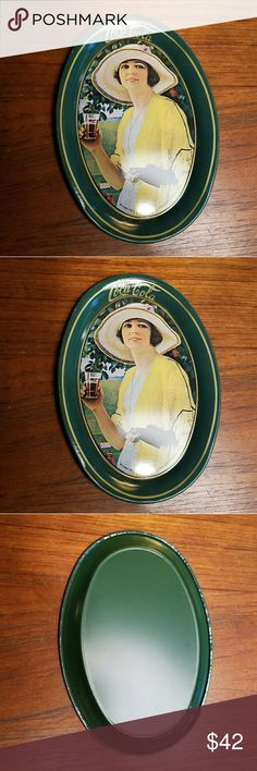 """*RARE* Vintage 1973 Coca Cola Tin Tray Awesome little piece of history. Photo is a 1920 depiction of a woman drinking a Coke mini. Trays/tins were printed in 1973. Great for holding jewelry or even used as a coaster. Approx 6 x 4.33"""" (I have a lot more Vintage Coca Cola in store & offer a 20% discount on 3+ items!) Vintage Other"""