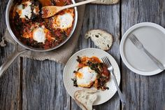 Eggs in a Wintry Tomato and Kale Sauce recipe on Food52.com  this would be amazing for breakfast, lunch, or dinner.