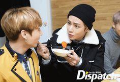 Tae feeding the maknae!