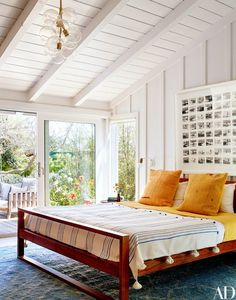 Another thing every 30-something should have: seasonal bedding à la the master bedroom of Mike D of the Beastie Boys' Malibu home, devised by architect Barbara Bestor.