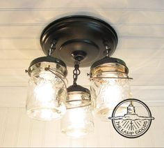 Mason Jar Ceiling Lighting Fixture - Vintage Pint Trio - Farmhouse Flush Mount Chandelier Light Track Fan Rustic Kitchen by LampGoods by LampGoods on Etsy https://www.etsy.com/listing/152723518/mason-jar-ceiling-lighting-fixture