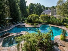 Pool, hot tub, and seating area of luxury home in Greenwich, Connecticut