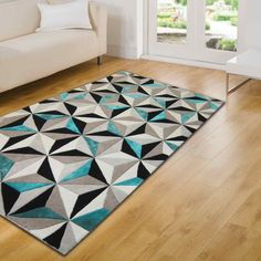 The soft pile features a Black, white with shimmering teal fibres that offer a sophisticated look for your floor. #Interiors #Abstract